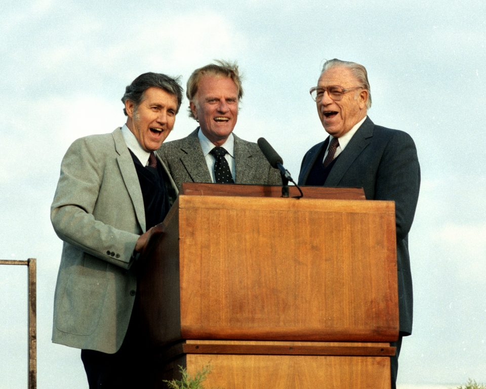 "A candid capture from 1984 of Cliff Barrows (L), Billy Graham and George Beverly Shea (R) singing ""This Little Light of Mine"" as they sometimes did together. Watch a video of the trio singing."
