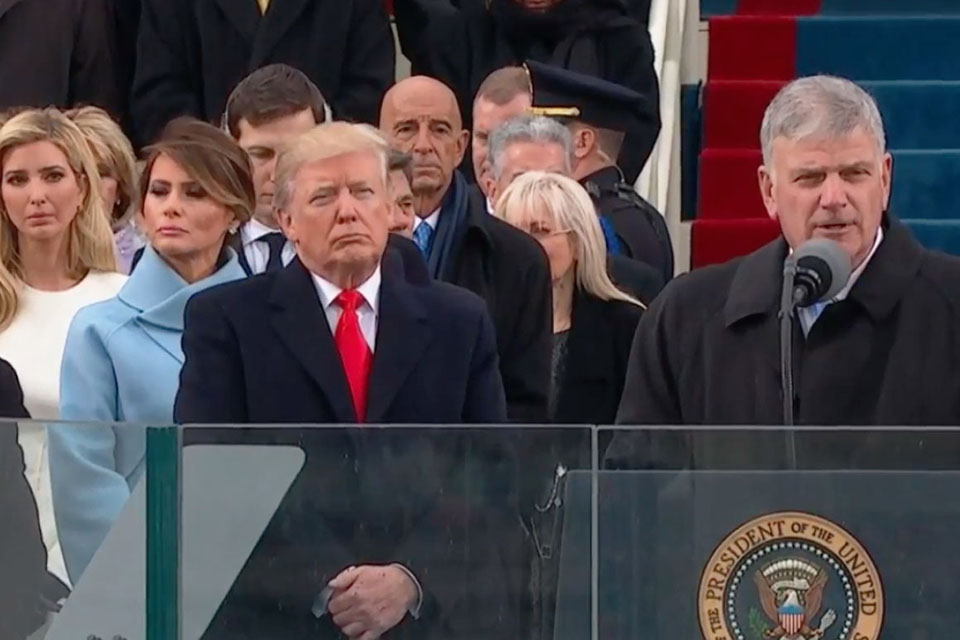 President Donald Trump listens as Franklin Graham reads a passage of Scripture during the inaugural ceremony in Washington, D.C.